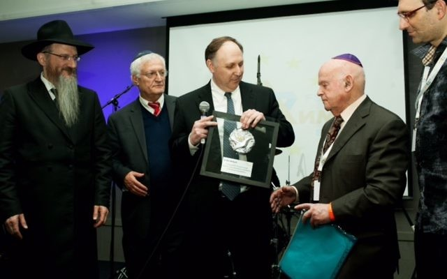 Holocaust survivor Ben Helfgott receiving his award.