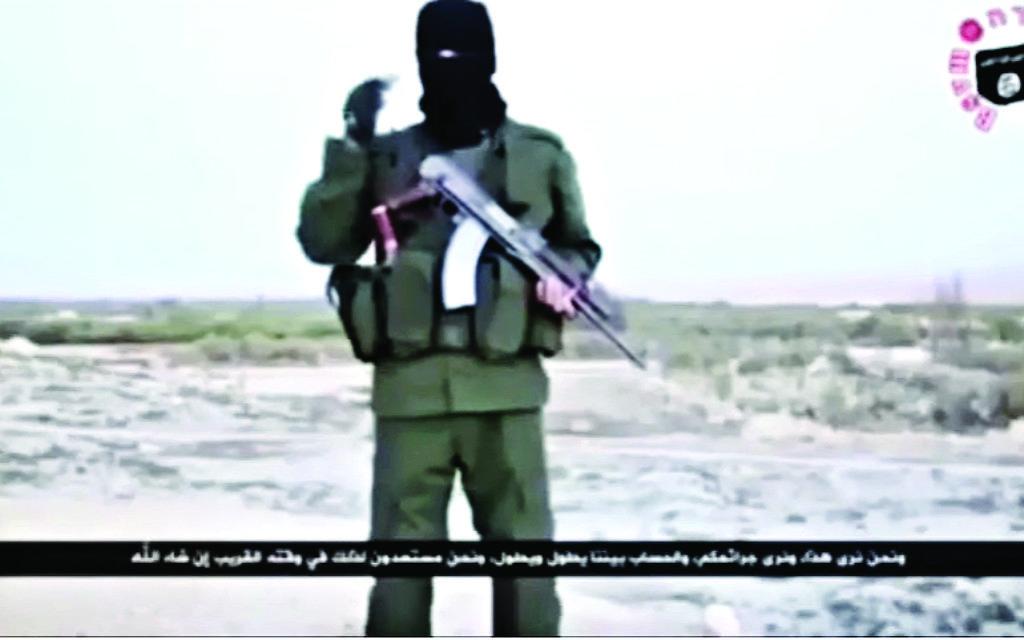 An ISIS member addresses Israelis in Hebrew in a video in 2015