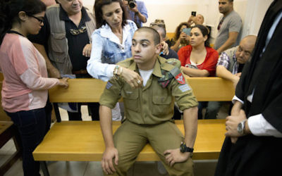 FILE - In this Monday, April 18, 2016 file photo, Israeli solider, Sgt. Elor Azaria, sits inside an Israeli military court in Tel Aviv, Israel. (AP Photo/Ariel Schalit. File)