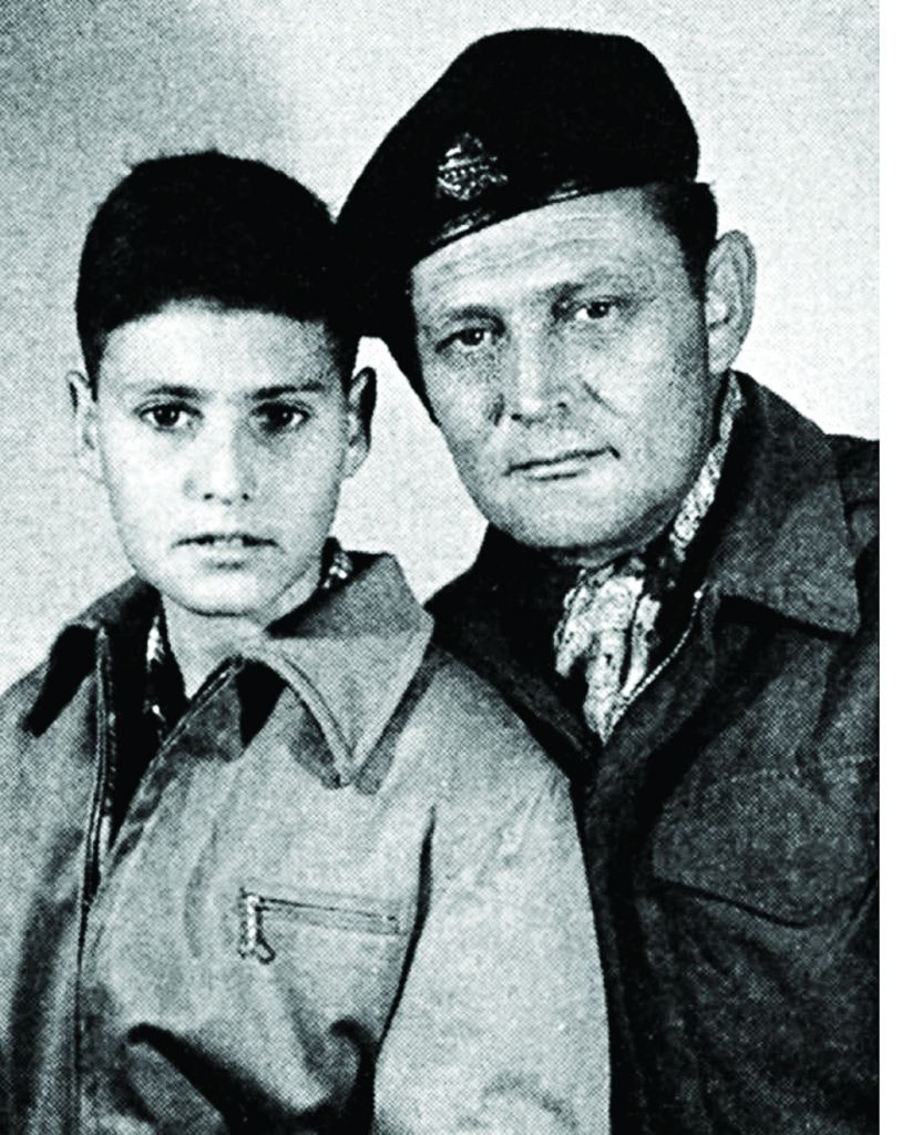 Uri aged 11 with his father, Tibor