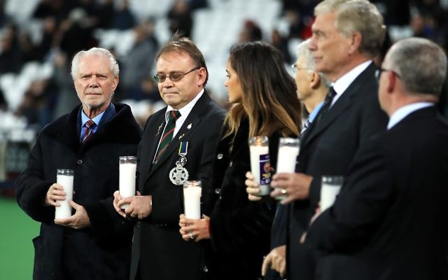 West Ham United co-chairman David Gold (left) holds a candle for Holocaust Memorial Day before the game