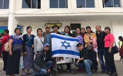 Unfurling an israeli flag at Lengpui airport