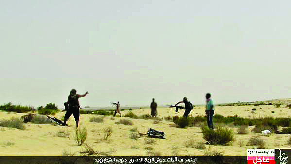 A still of an ISIS member during an attack against the Egyptian army