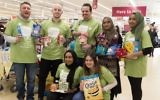 Jewish and Muslim volunteers collecting on Sadaqa Day