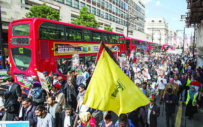Hezbollah flags waved by pro-Palestinian supporters during the anti-Israel Al-Quds Day rally in London.    (Photo credit should read: Rick Findler/PA Wire