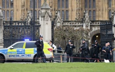 Police close to the Palace of Westminster, London, after sounds similar to gunfire have been heard close to the Palace of Westminster. A man with a knife has been seen within the confines of the Palace, eyewitnesses said. (Photo credit: Victoria Jones/PA Wire)