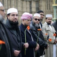 Muslim leaders pay respects at vigil held on Westminster Bridge in London, exactly a week since the Westminster terror attack took place. (Photo credit: Yui Mok/PA Wire)