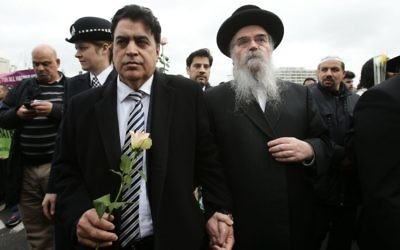 Rabbi Avraham Pinter (right) attends a vigil held on Westminster Bridge, exactly a week since the Westminster terror attack took place. (Photo credit: Yui Mok/PA Wire)