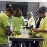 Jewish and Muslim volunteers cooking a three course meal for the homeless together, on Sadaqa Day