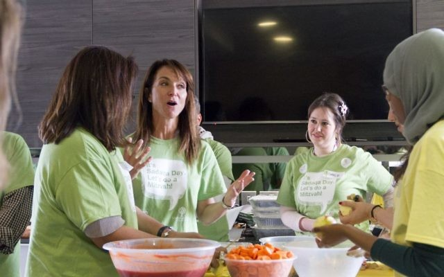 Daniella Pears of the Pears Foundation and Mitzvah Day (second left) taking part in Sadaqa Day