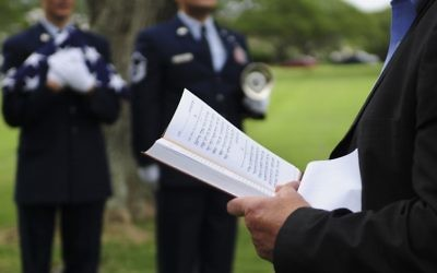 A prayer is read during a memorial service for Staff. Sgt. Jack Weiner, U.S. Army Air Forces, at the National Memorial Cemetery of the Pacific, Feb. 28, 2017.    (U.S. Air Force photo by Tech. Sgt. Heather Redman)