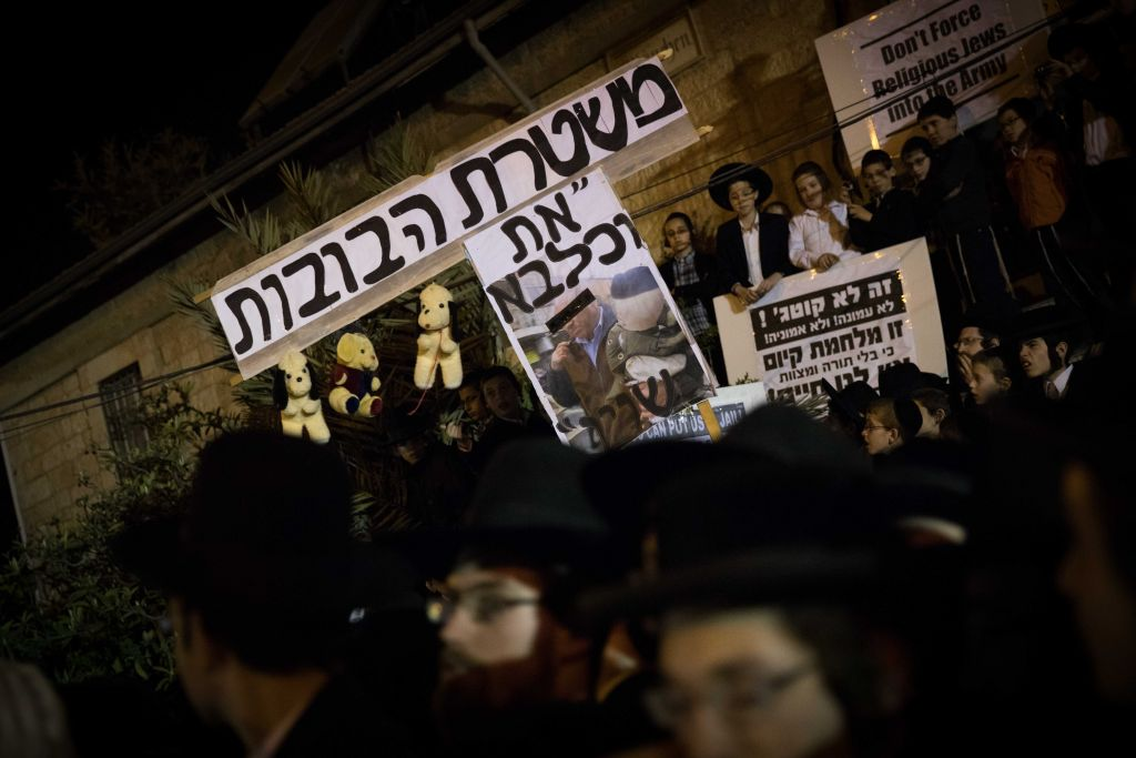 Thousands of ultra orthodox Jews protest the arrest of ultra-Orthodox draft dodgers, as they attend a rally against army recruitment in Jerusalem. (Photo by: JINIPIX)