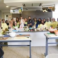 Jewish and Muslim volunteers pose together after cooking a three course meal for the homeless together, on Sadaqa Day