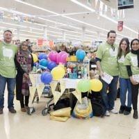 Jewish and Muslim volunteers collecting on Sadaqa Day