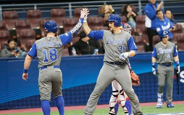 Team Israel celebrate their second win of the World Baseball Classic on Tuesday