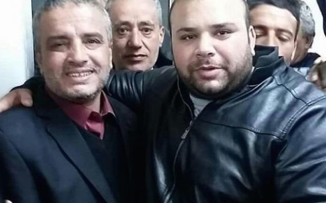 Ahmed Daqamseh (l) celebrating his release from prison