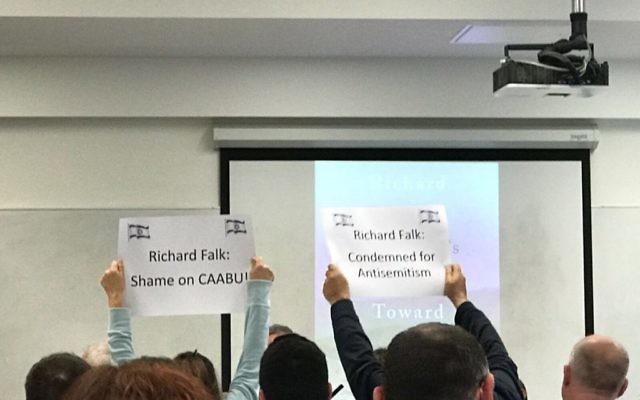 Pro-Israel protesters hold up signs during the event (Source: Elad Simchayoff on twitter)