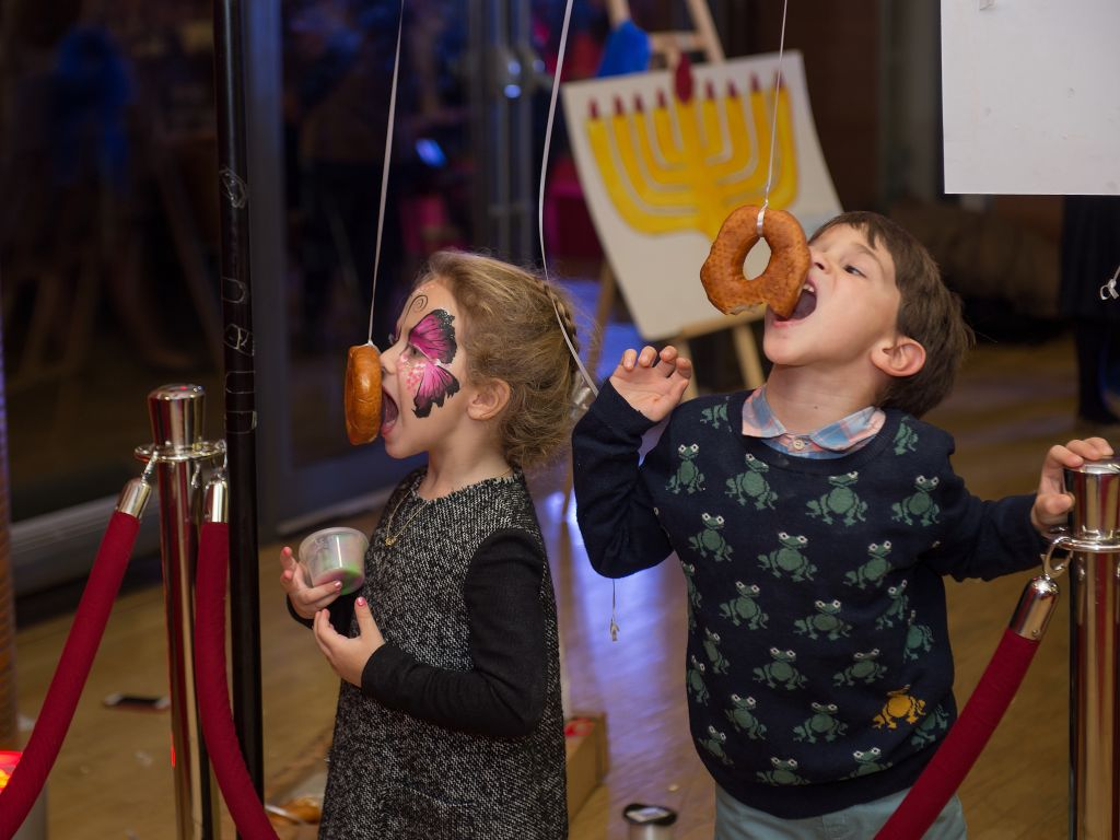 Children enjoy doughnuts at Chabad Belgravia