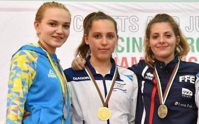 Vera Kanevski (middle) with her gold medal