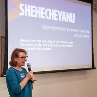 Maureen Kendler speaking at an interfaith seder in March 2017