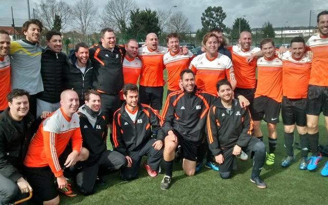 L'Equipe celebrate lifting the Division Two title