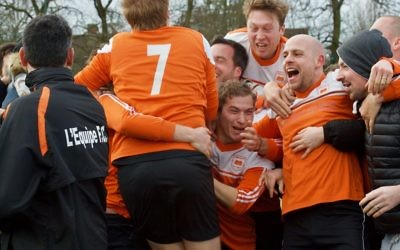 L'Equipe celebrate winning Division Two