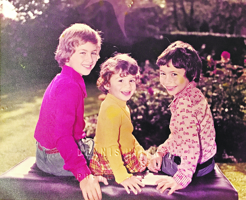 Laura Cowan (centre) with her 2 brothers