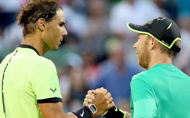Nadal commiserates with Sela after beating him in their second round clash
