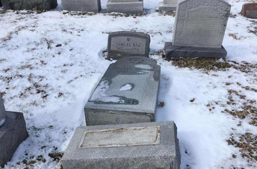 Headstones were toppled at the Waad Hakolel Cemetery, also known as the Stone Road Cemetery, in Rochester, N.Y. (Courtesy of News 10 NBC WHEC) (Via JTA)