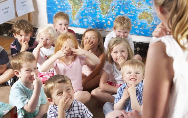 Kids learning in a primary school classroom