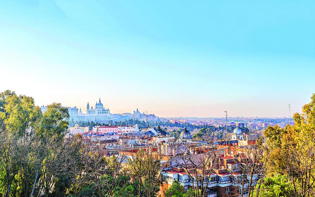 Sunrise panorama of Madrid with Royal Palace and  Almudena Cathedral.