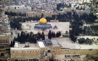 An aerial view of the Temple Mount in the Old City of Jerusalem, featuring the Golden Dome of the rock and Al Aqsa mosque