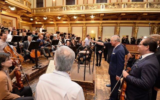 The Prince of Wales looks at an orchestra at the Musikverein concert hall in Austria on the ninth day of his European tour. (Photo credit: John Stillwell/PA Wire)
