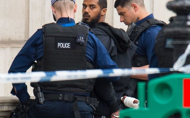 Armed police detaining a man following an incident in Whitehall, London. Terror police have been granted more time to question a suspected knifeman arrested in the heart of Westminster following a targeted swoop. (Photo credit: Dominic Lipinski/PA Wire)