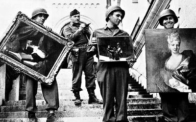 Nazi soldiers pose with Nazi-looted art