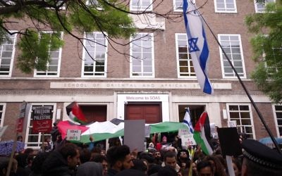 Israeli and Palestinian protestors outside the building in which the event took place