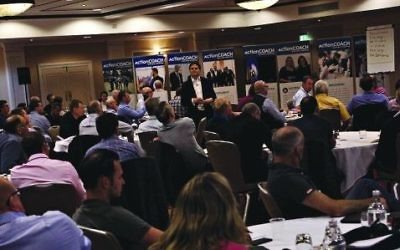 Jamie Goral, centre, shares some of his client profit growth journeys with ActionCOACH business coaches at the recent national conference