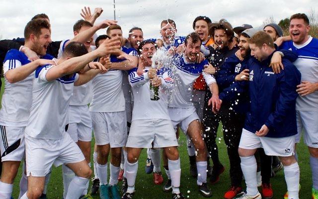 Redbridge B celebrate winning the Division One title