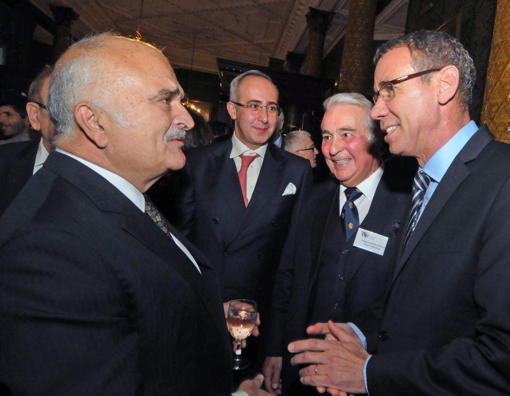 Prince El Hassan bin Talal (left) talking with Israeli Ambassador to the UK Mark Regev (right) Photo credit: John Rifkin