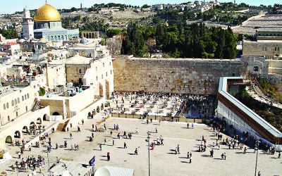 The Western Wall plaza, with the Dome of the Rock on top of Temple Mount