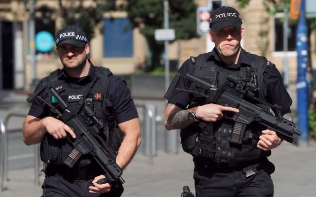 Armed police close to Manchester Arena, the morning after a suicide bomber killed 22 people after an Ariana Grande concert    Photo credit should read: Danny Lawson/PA Wire