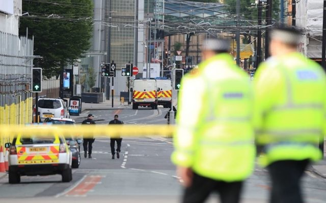 Police close to the Manchester Arena the morning after a terrorist attack at the end of a concert by US star Ariana Grande left 22 dead.   Photo credit: Peter Byrne/PA Wire