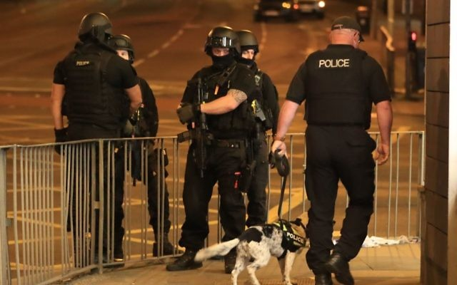 Armed police after a terrorist attack at the Manchester Arena at the end of a concert by US star Ariana Grande left 22 dead.   Photo credit: Peter Byrne/PA Wire
