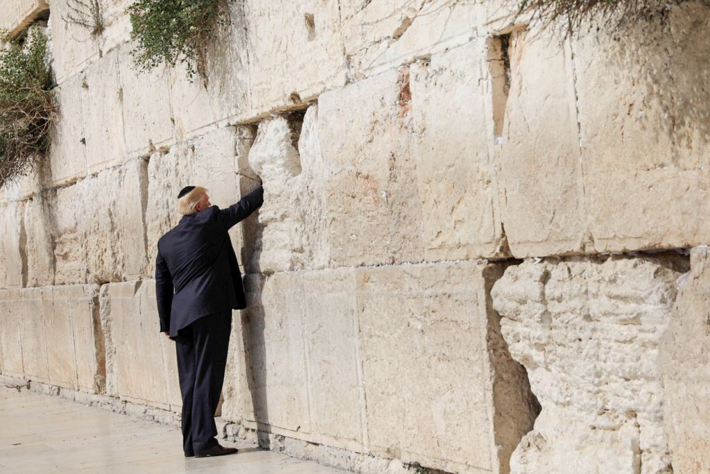 U.S. President Donald Trump places a note in the stones of the Western Wall, Judaism's holiest prayer site, in Jerusalem's Old City May 22, 2017. Photo by: Nati Shochat-JINIPIX