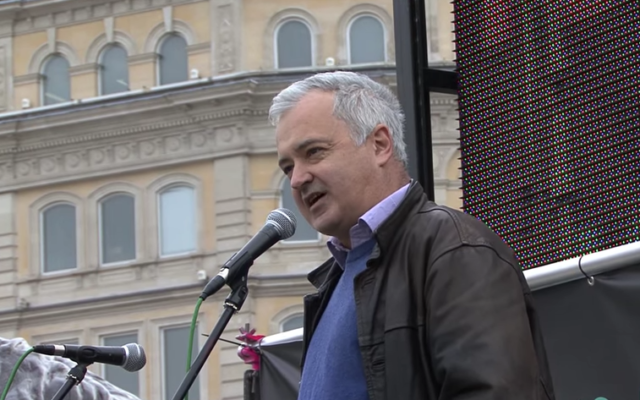 Andrew Murray speaking during a Stop The War Coalition demo (Screenshot from Youtube)