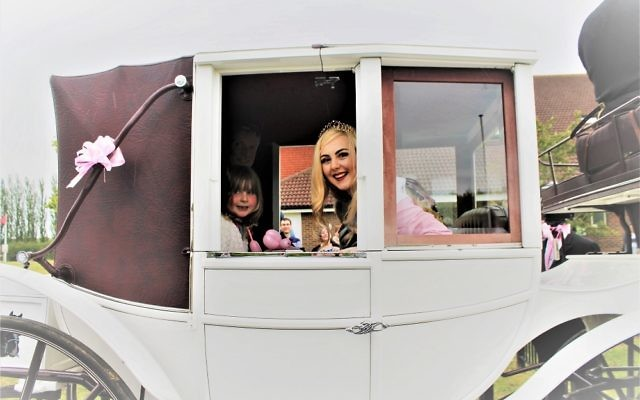 Naomi and Sleeping Beauty in the horse and carriage