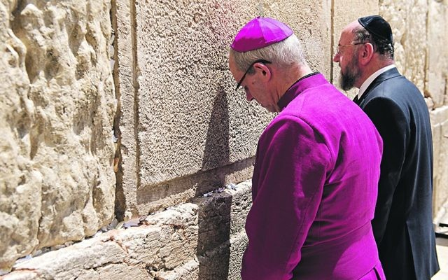 Chief Rabbi Ephraim Mirvis and Archbishop of Canterbury Justin Welby at the Western Wall in Jerusalem, praying together.