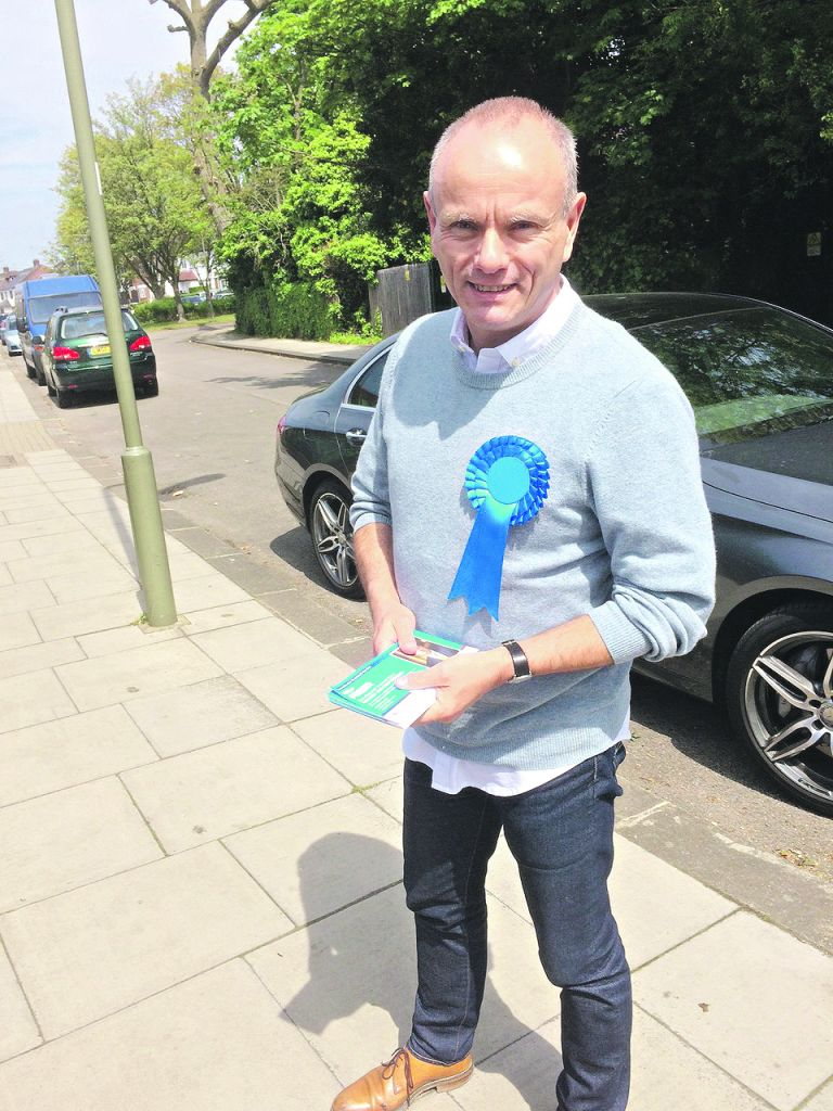Mike Freer on the campaign trail