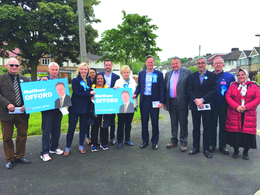 Matthew Offord, pictured third from the right, canvasses for votes with supporters in Hendon