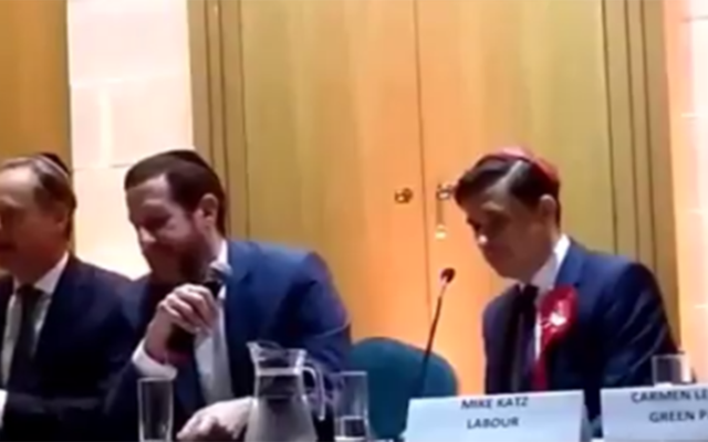 Matthew Offord, left, speaking at Mill Hill shul, with Labour's Mike Katz on the right